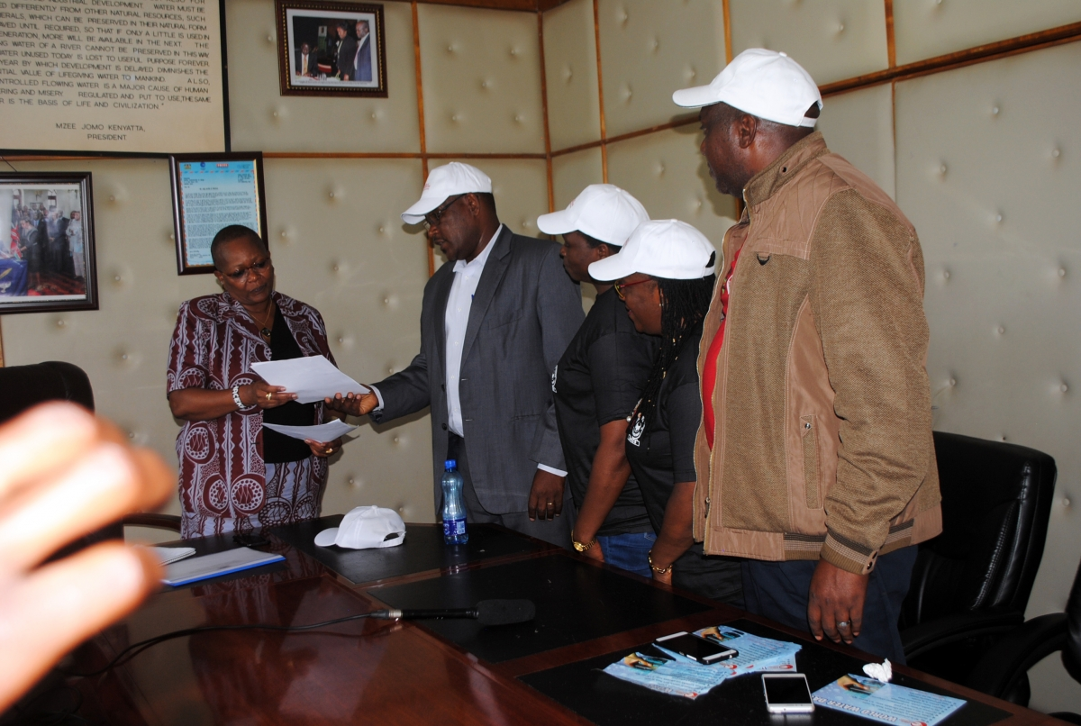 PSI team, including Sub-Regional Secretary, Everline Aketch, making a presentation of their petition to the Chief Administrative Secretary in Nairobi