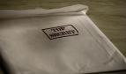 white envelope with Top Secret stamp in black