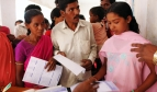 Enrolling for National Health Insurance in India. Photo: ILO