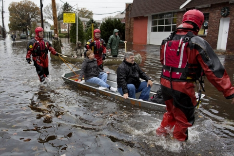 People being rescued from flooding in a boat