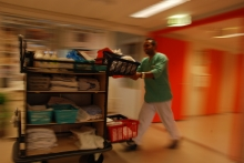 Assisting nurse with trolley