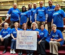 Group of AFT members holiding banner supporting the UN workers