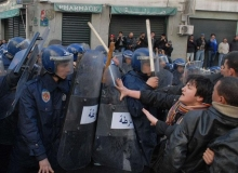 Police confronting demonstrators in Algeria