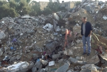 Saad Ismail standing in the ruins of the family home where six family members were killed