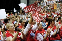 "Nurses demonstrating. Banner says ""Nurse ratios save lives"""