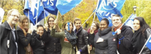 Quebec union members holding flags