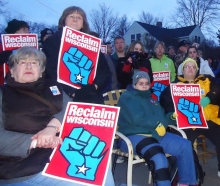 Wisconsin residents holding up Reclaim Wisconsin posters