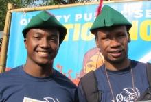 Two young men wearing Robin Hood caps