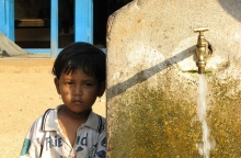 Child near water tap in Nepal, photo by niOS