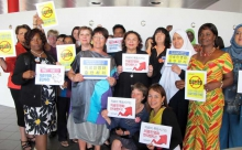 PSI Women's Committee hold banners in solidarity with Korean health workers