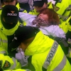 Police removing striking worker from sit-in
