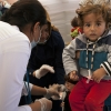 Health workers caring for refugees