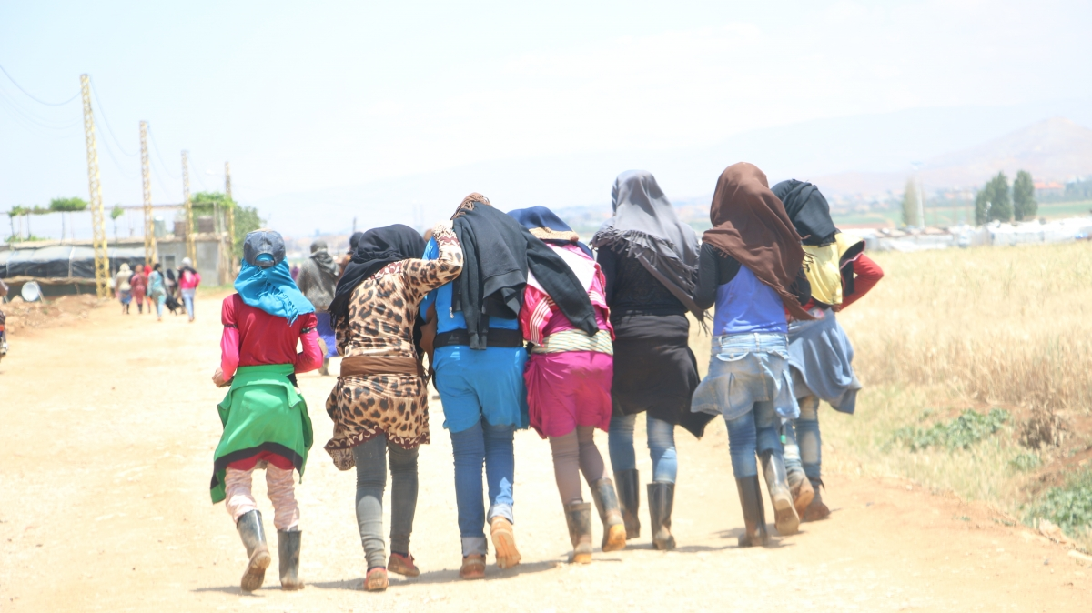 Syrian women walking back from the fields after a days work