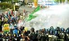 Police use water cannon againt protestors in Daegu, Korea