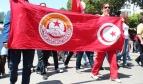 Demonstrators carry a UGTT banner