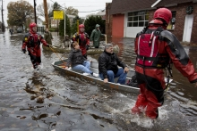People being rescued in boats after Hurricane Sandy, March 2013