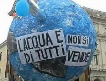 Model of the earth with slogans in Italian