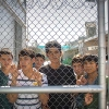 Refugees behind a wire fence