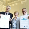 Three people holding Blue Planet Project cerificates