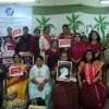 Participants to the forum holding the different GUF posters