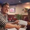 James Ellsmore of Solar Head of State receives donation of prize money from Helene Davis-Whyte, general secretary of JALGO