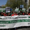 Rally against FTT in Washington with Rosa Pavanelli holding banner