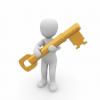Logo person holding large yellow key